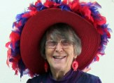 Lorraine wearing large Red Hat