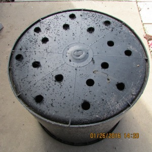 Black planter with holes in bottom