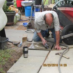 Setting large cement blocks