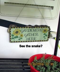 Snake on garden sign
